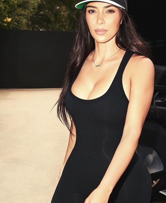 Kim Kardashian donning a figure hugging bodysuit with a stretch fabric, a scoop neck and straps