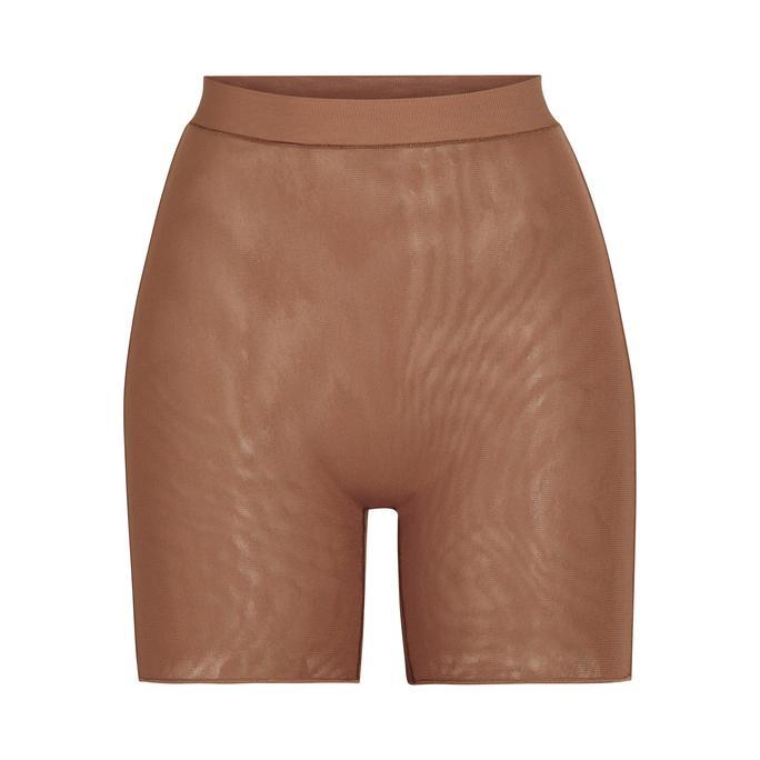 Kim Kardashian rocking Brown luxe loungewear Skims mesh brief with a mesh material