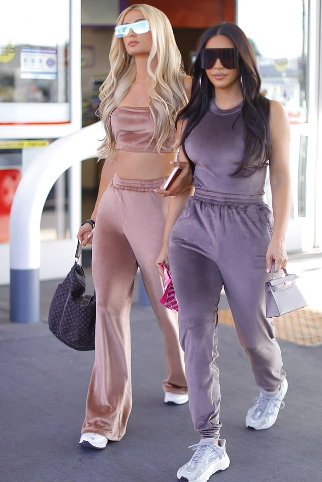 Kim Kardashian donning a shiny purple luxe velvet crop top with a crew neck