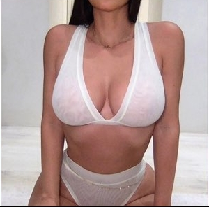 Kim Kardashian wearing White luxe loungewear Skims mesh thong with a mesh fabric