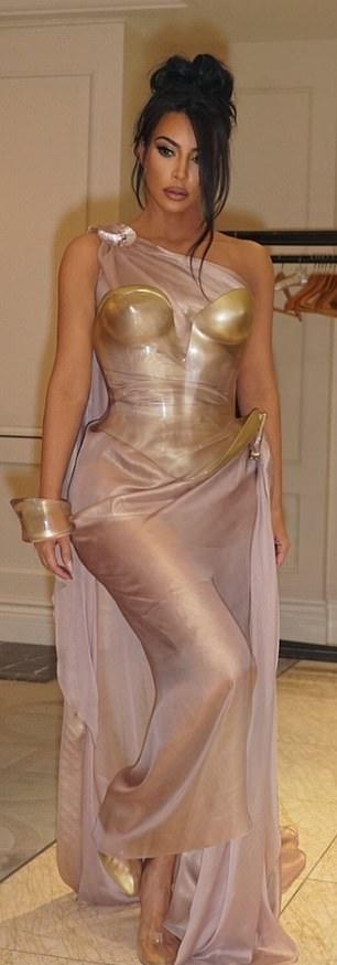 Kim Kardashian rocking narrow gold PVC pumps with high heel