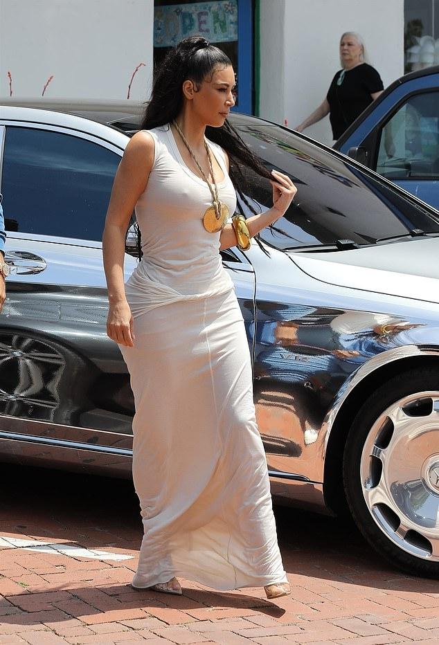 Kim Kardashian rocking transparent light grey Yeezy pumps with pointy heel
