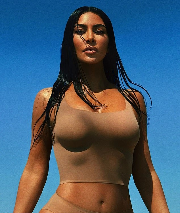 Kim Kardashian rocking a Figure hugging beige tank top with a scoop neck and straps