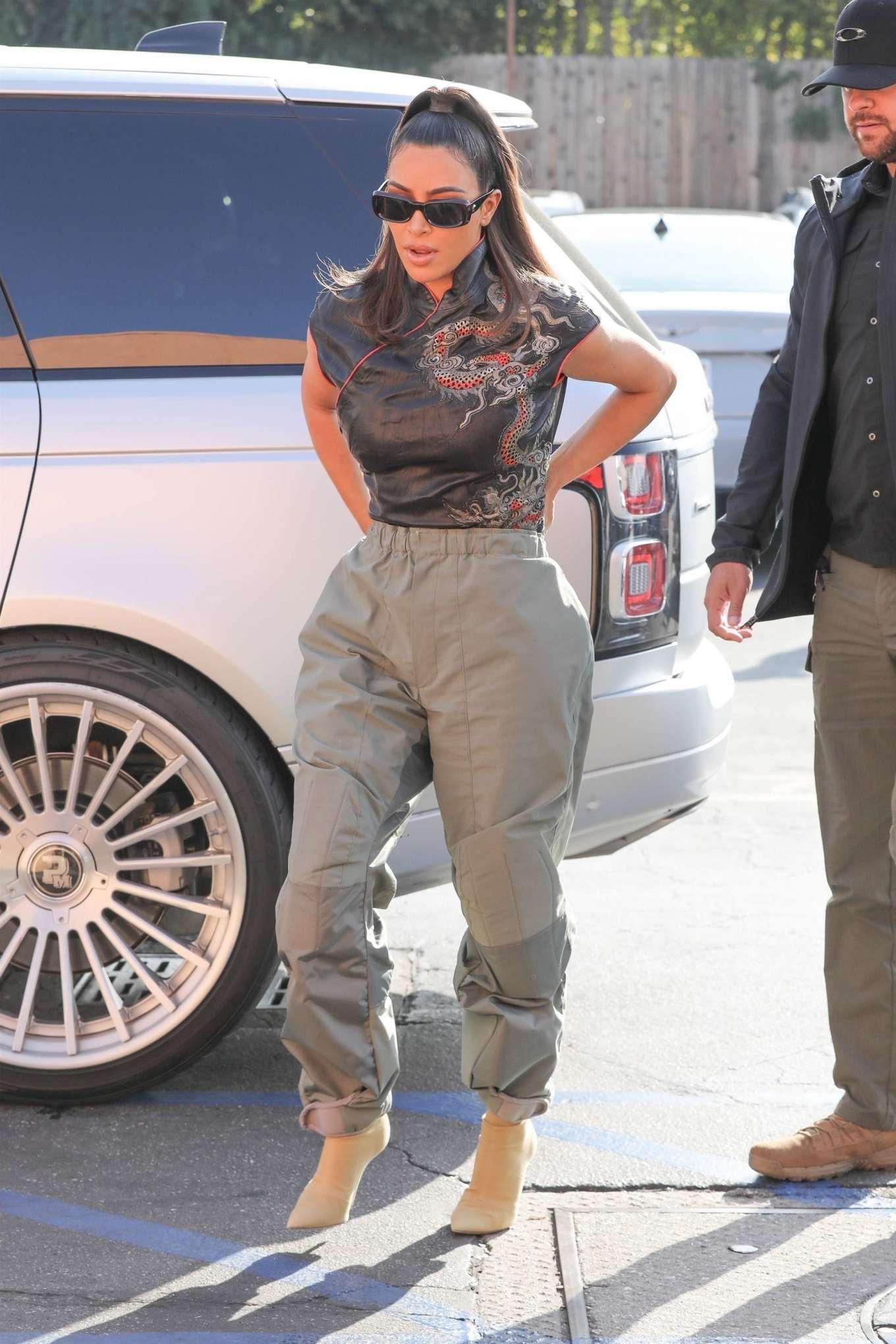 Kim Kardashian wearing pointy Nude sock boot with high heel