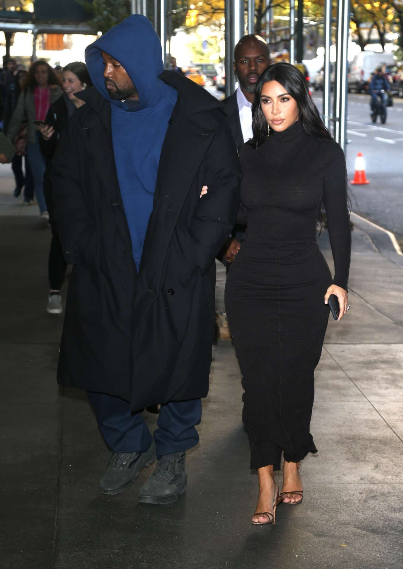 Kim Kardashian wearing a Formfitting black dress with full sleeves, striped and a turtleneck