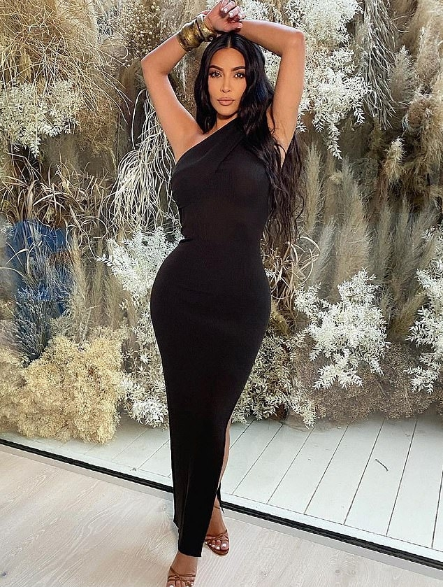 Kim Kardashian rocking round brown multi straps sandals with high heel