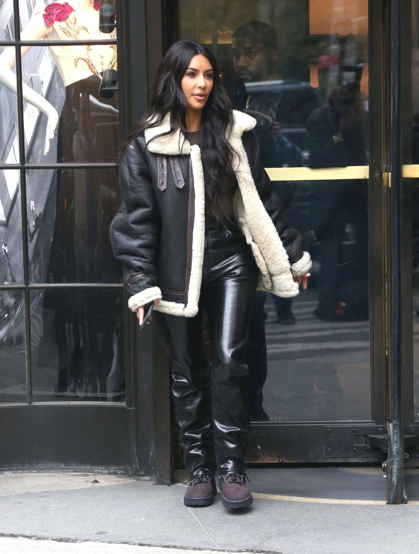 Kim Kardashian wearing burgundy lace-up boots with chunky sole