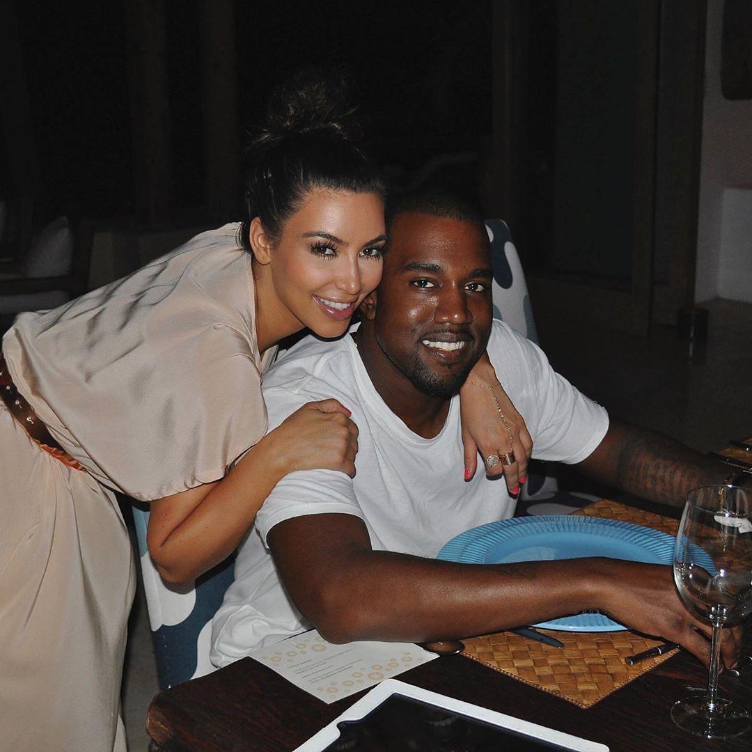 Kim Kardashian rocking a Shiny cream satin dress with a satin material and short sleeves