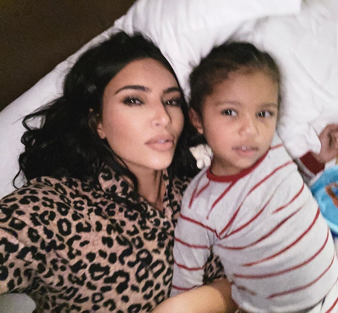 Kim Kardashian donning a Cream black leopard shirt pajama set with shirt collar and button front