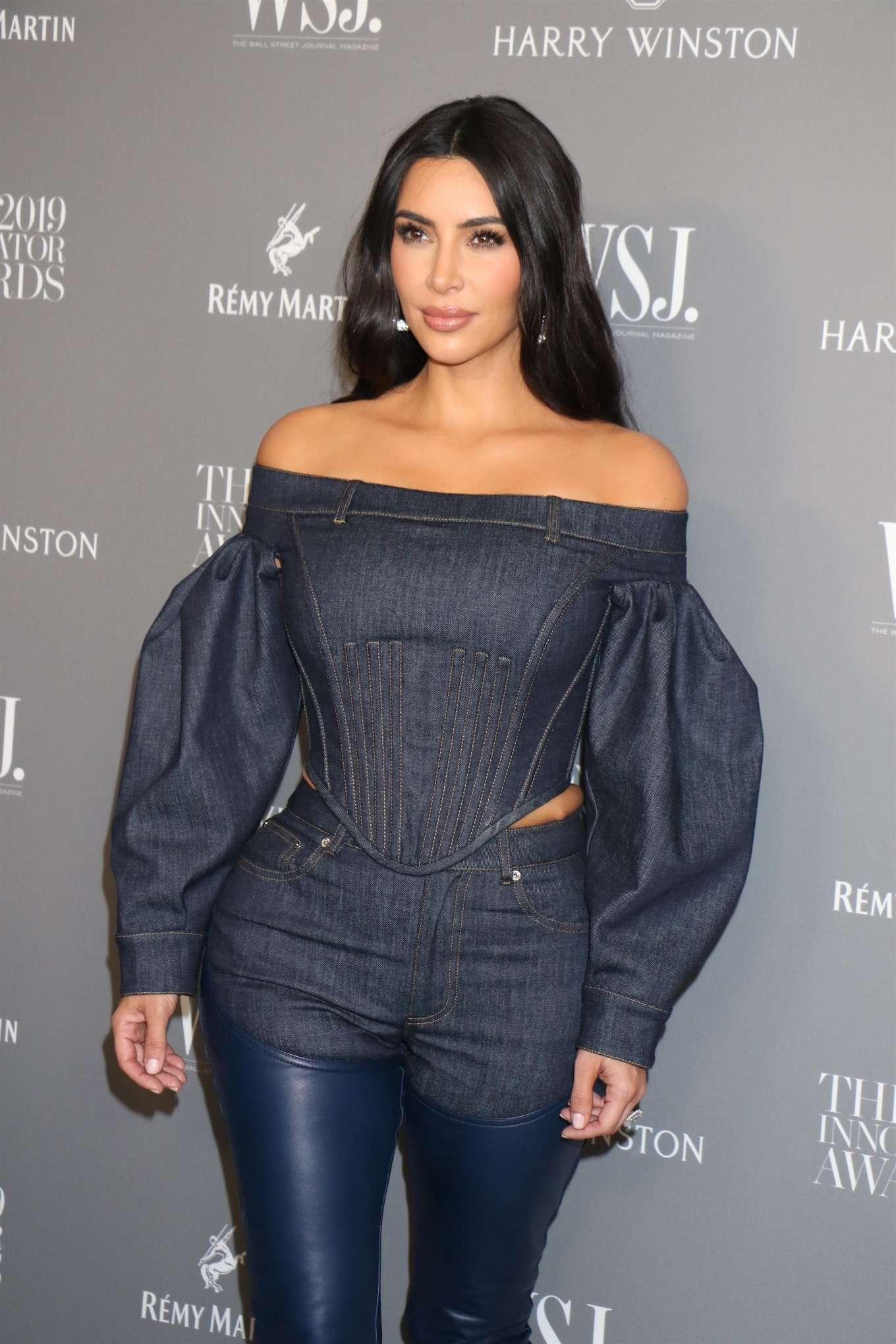 Kim Kardashian, dark blue boots, leather, dark blue Burberry blouse, pointy heel, narrow, thigh high, dark blue Burberry jeans, pointy. Kim Kardashian donning pointy dark blue leather thigh high boots with pointy heel
