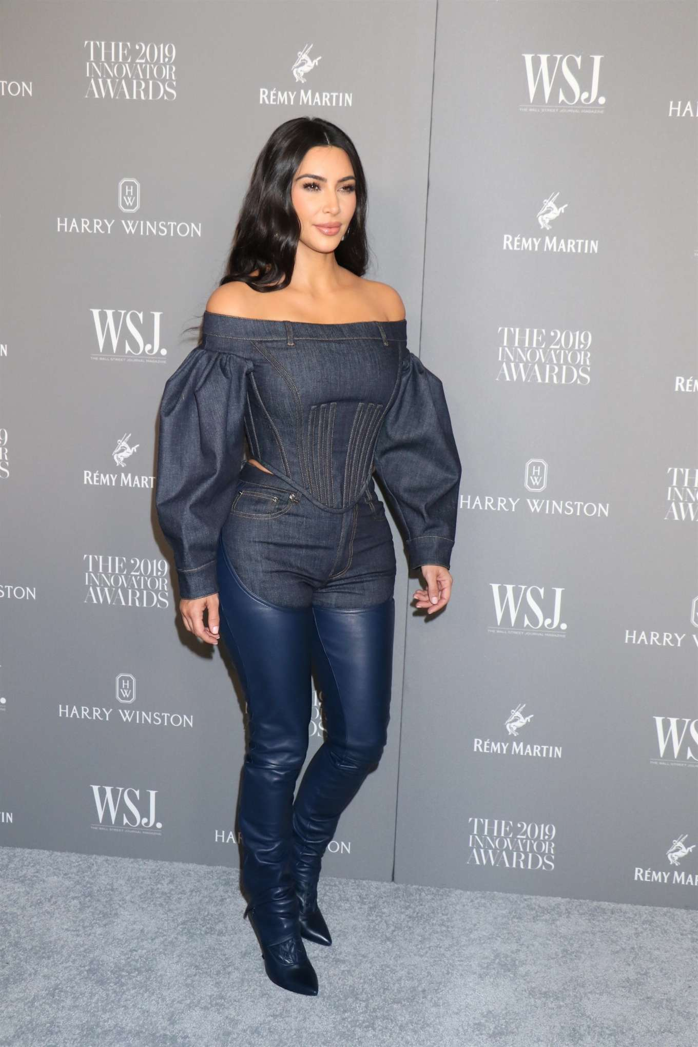 Kim Kardashian, dark blue boots, leather, dark blue Burberry blouse, narrow, thigh high, pointy heel, dark blue Burberry jeans, pointy. Kim Kardashian donning pointy dark blue leather thigh high boots with pointy heel
