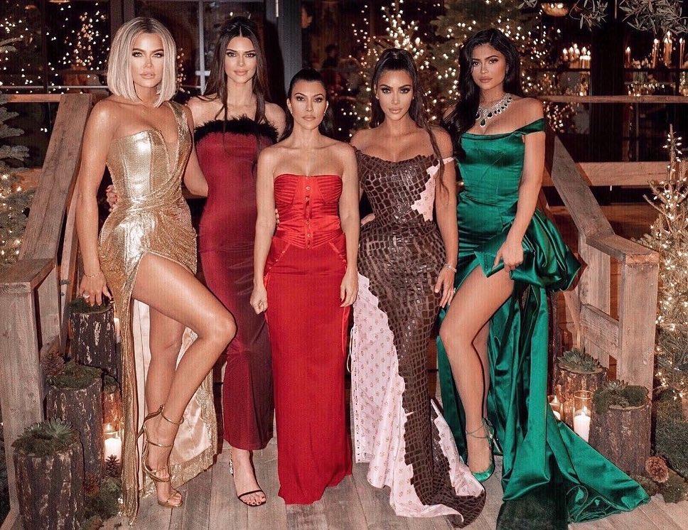 Kim Kardashian rocking a Sexy dark brown crocodile skin maxi dress with crocodile skin, pattern and a asymetrical neckline