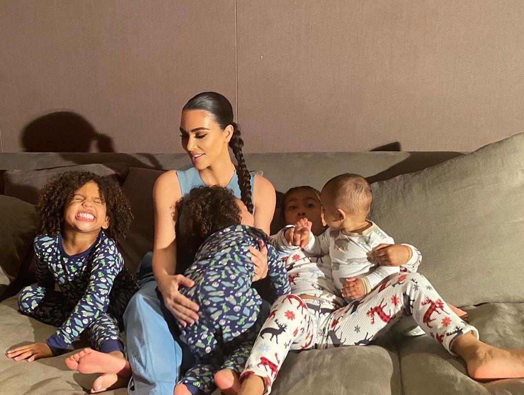 Kim Kardashian donning Baggy dusty blue high rise sweatpants