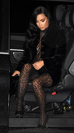 Kim Kardashian donning see-through light grey Yeezy pumps with pointy heel