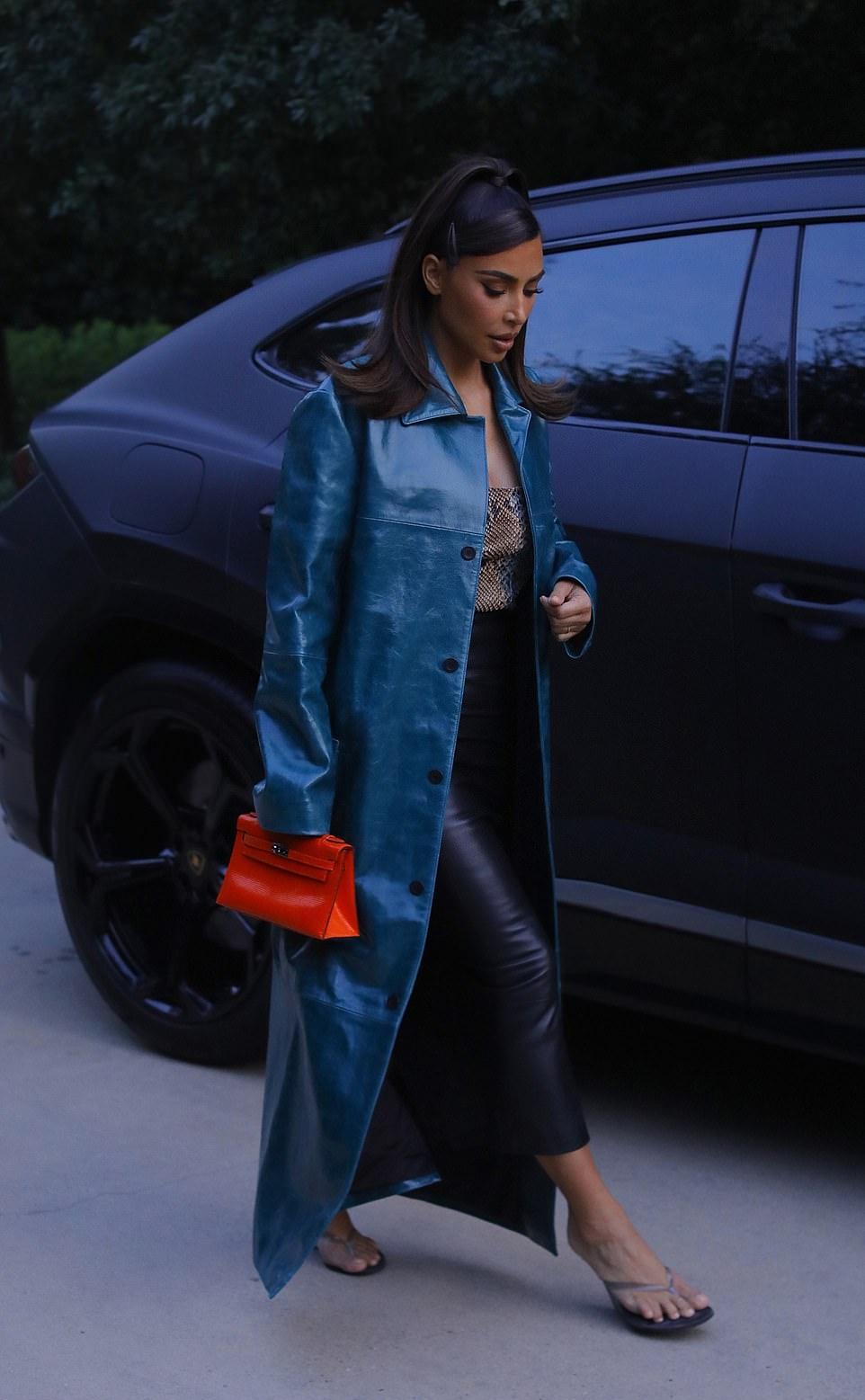 Kim Kardashian rocking a beige snakeskin bodysuit