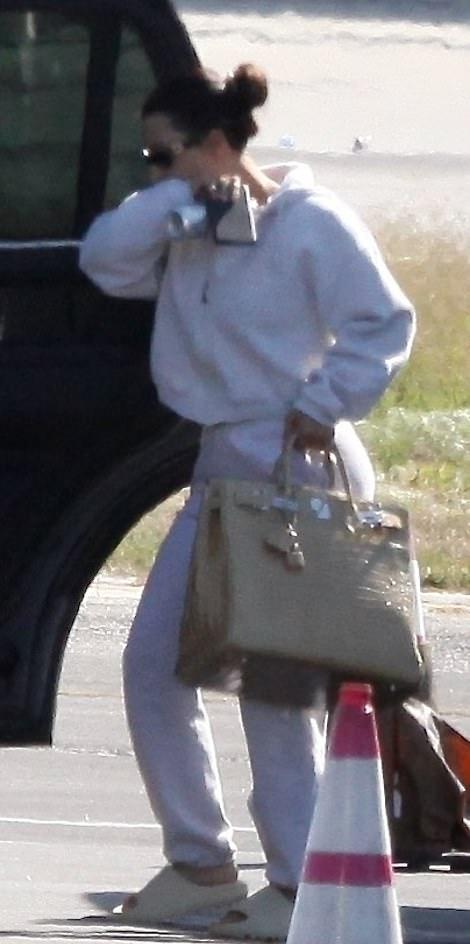 Kim Kardashian wearing baggy grey high rise sweatpants