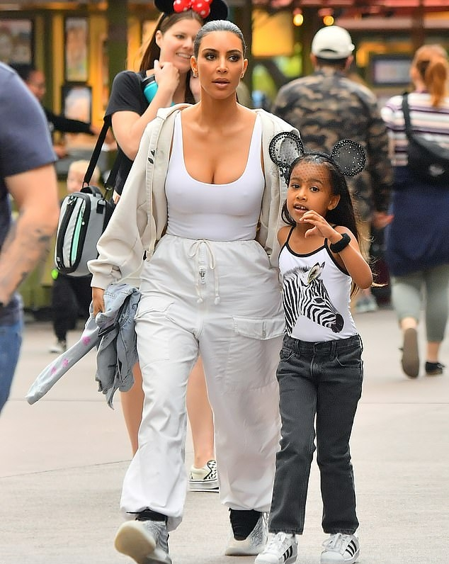 Kim Kardashian donning a Figure hugging grey tank top with a scoop neck and straps