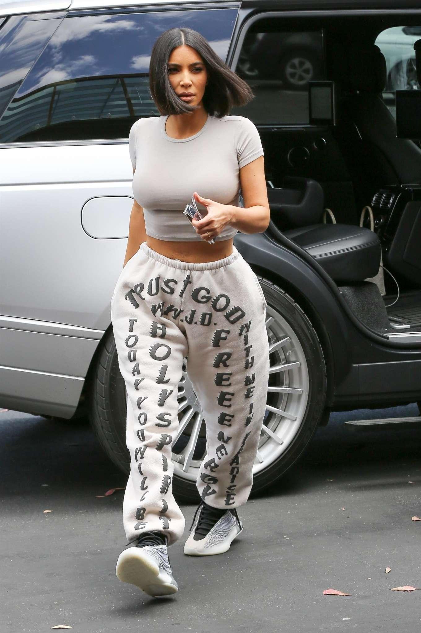 Kim Kardashian wearing Yeezy light grey printed sweatpants with side pockets, elastic belt waist and ribbed hem