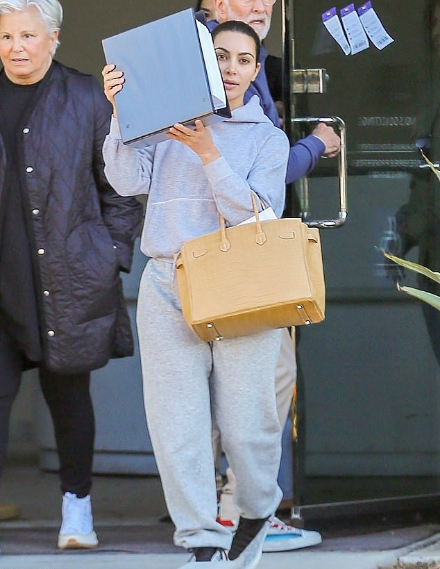 Kim Kardashian wearing Grey baggy sweatpants with a woolen material