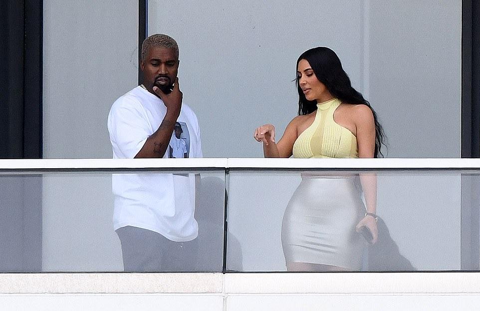 Kim Kardashian rocking see-through light grey Yeezy pumps with pointy heel