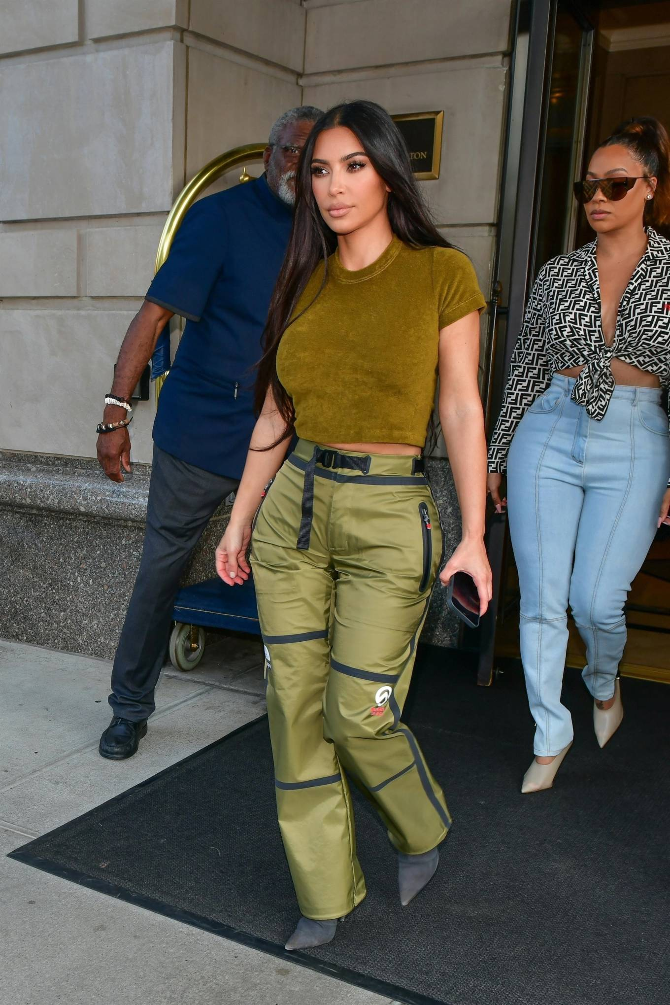 Kim Kardashian rocking a fitted military green tee with a velvet material, short sleeves, brand logo and a crew neck