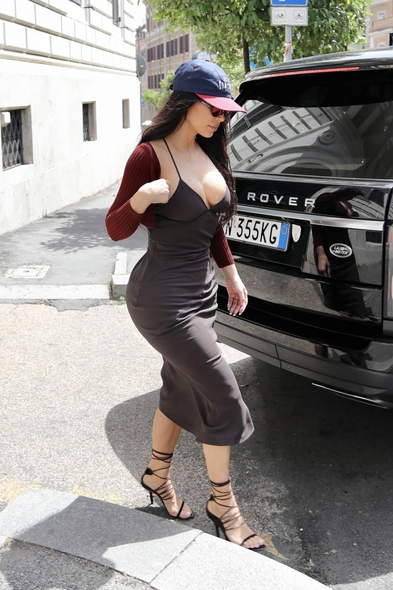 Kim Kardashian rocking a red open front velvet cardigan with full sleeves
