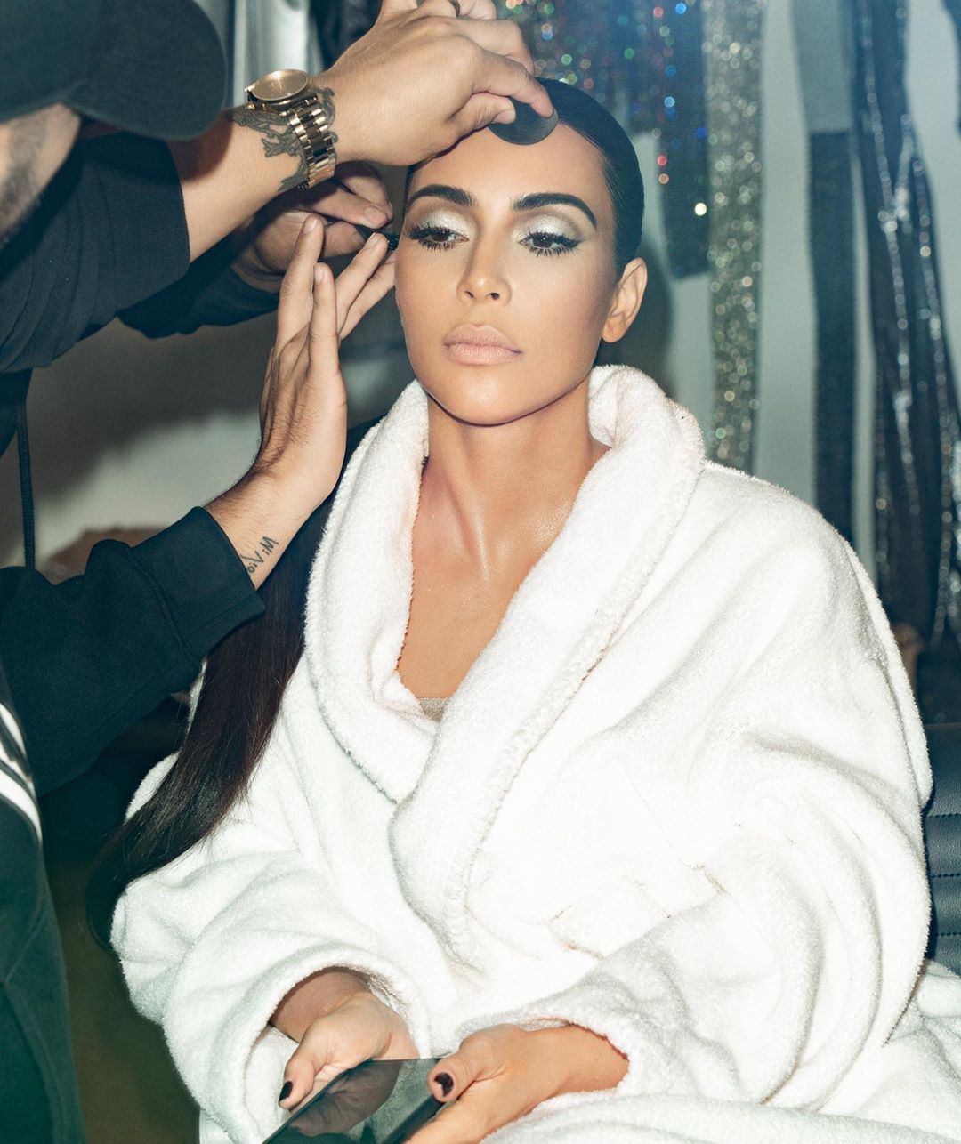 Kim Kardashian rocking a Formfitting light grey dress with a deep sweetheart neckline