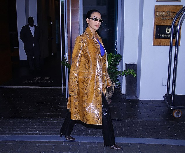 Kim Kardashian donning a Tan Marnix Marni snakeskin leather coat with a leather fabric, extra long sleeves, shirt collar and button front