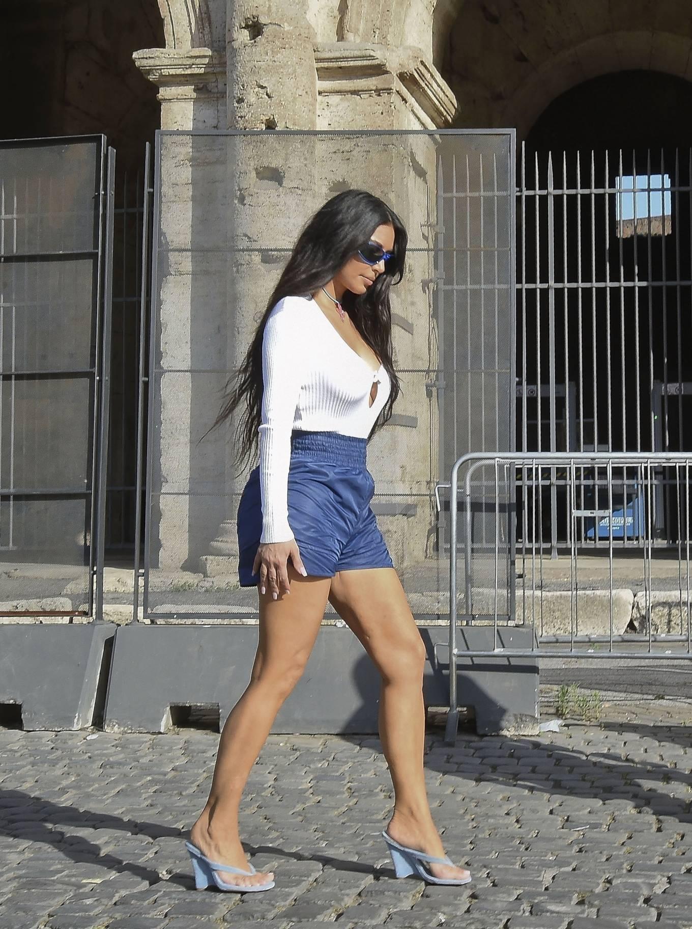 Kim Kardashian rocking round light blue white slip on slippers with wedge heel