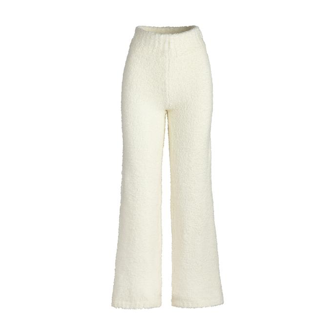 Kim Kardashian rocking Cream shearling matching sweatpants with a shearling material and elastic belt waist
