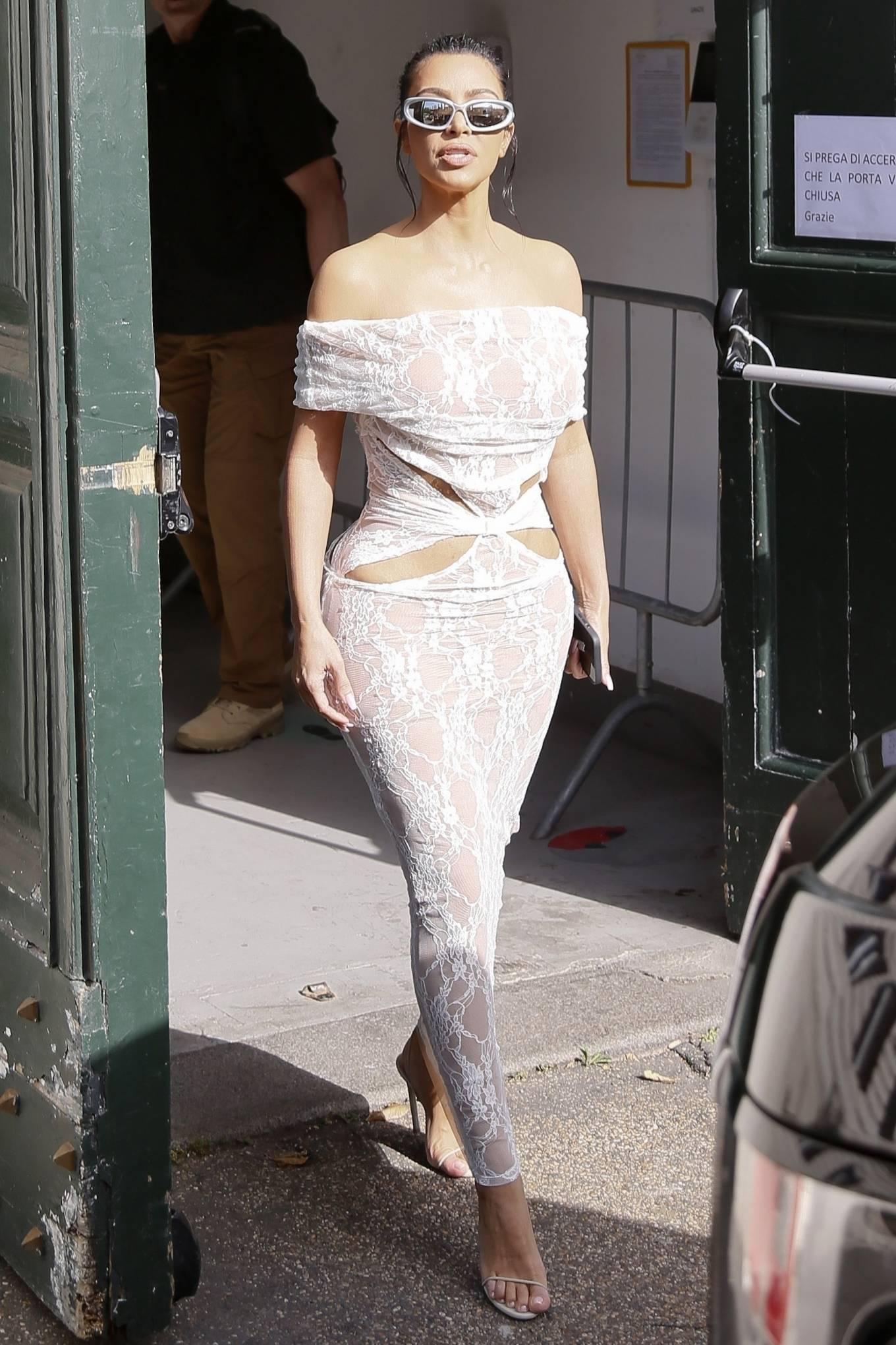 Kim Kardashian donning sharp white sandals with high heel