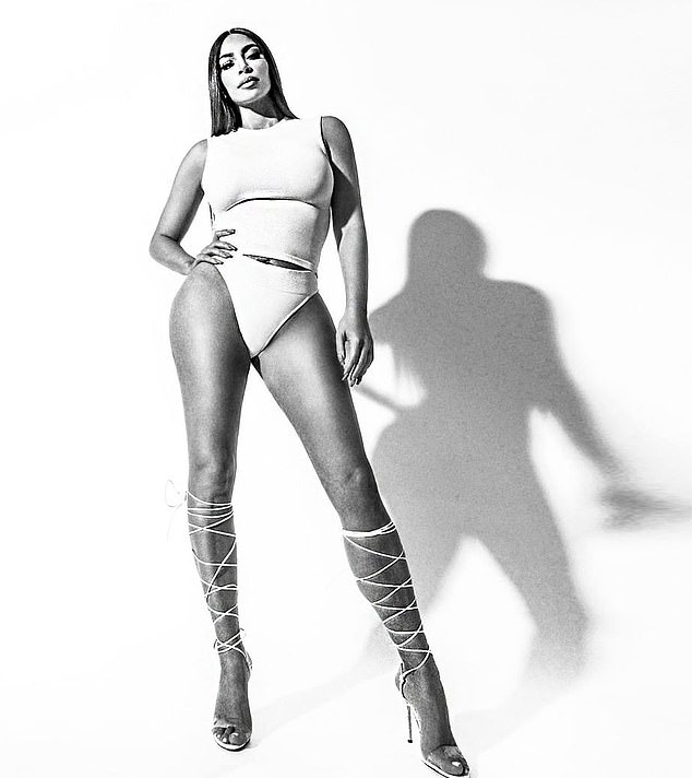 Kim Kardashian donning white over the knee sandals with high heel and thin straps
