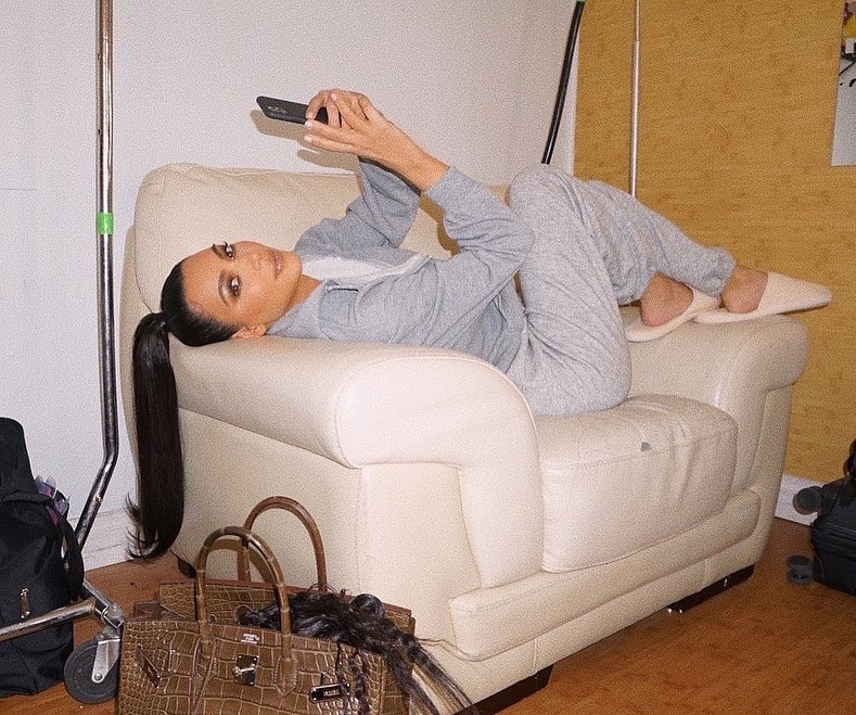 Kim Kardashian, white  slippers, grey sweatshirt, brown Hermes purse, round, grey track pants