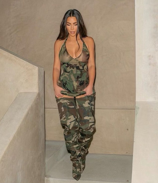 Kim Kardashian rocking narrow multicolor canvas over the knee boots by Vetements with stiletto heels and cargo pockets