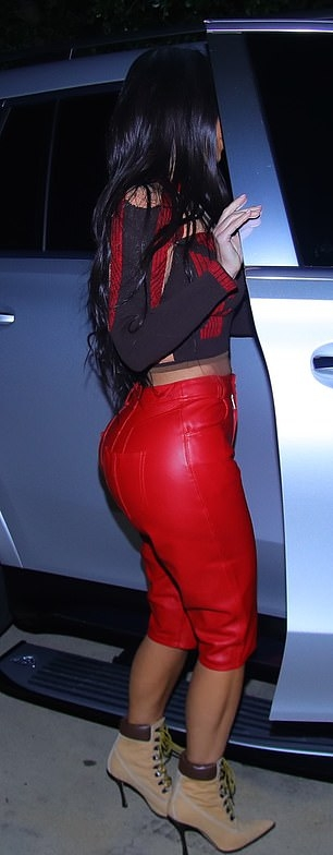 Kim Kardashian, Nude  boots, leather, Manolo Blahnik  boots, black and red Yeezy crop top, stiletto heels, pointed, ankle, brown  boots, figure hugging red capri, high heel, narrow, lace-up, sharp