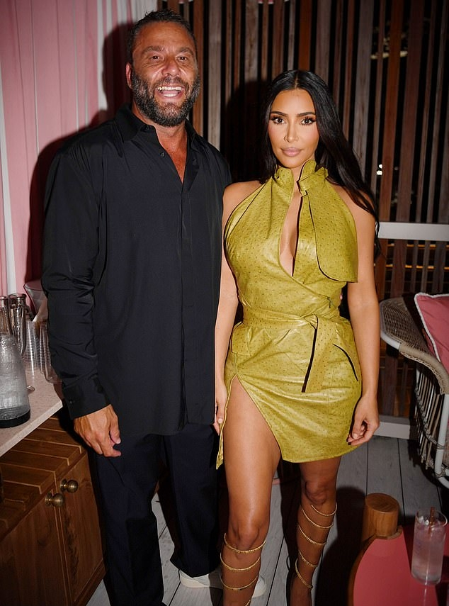 Kim Kardashian rocking a figure hugging Christian Dior dress with a leather material, stand-up collar and asymmetric design
