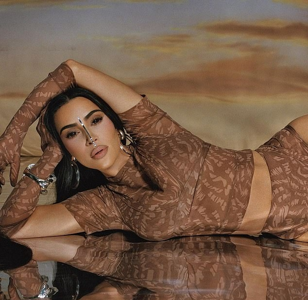 Kim Kardashian donning a very low V-neck brown bralette while posing for extraterrestrial SKIMS shoot