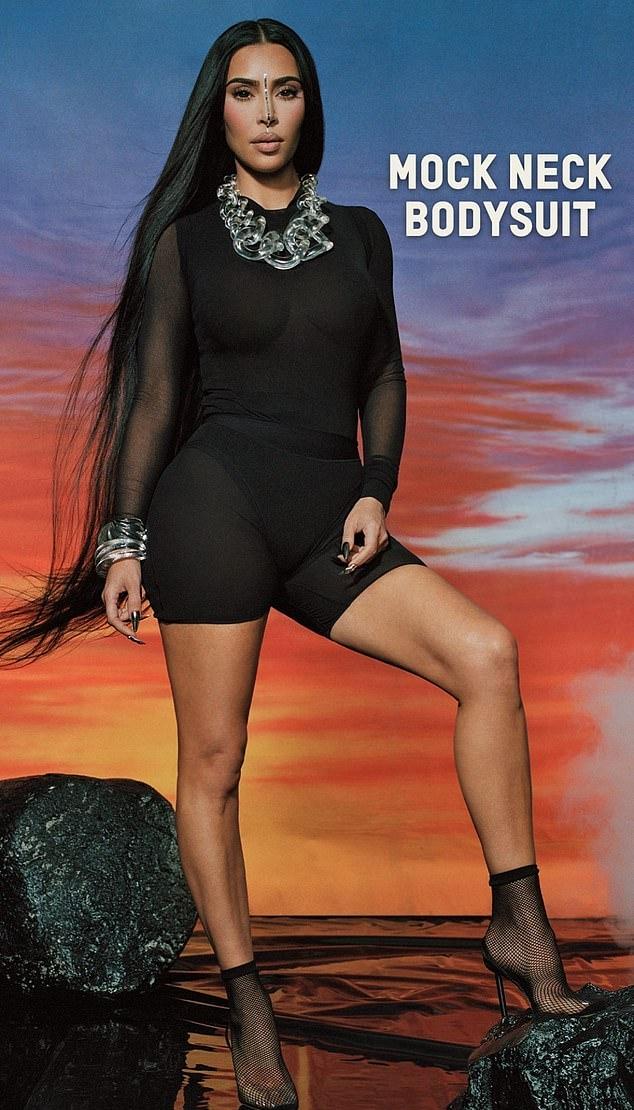 Kim Kardashian wearing narrow black mesh ankle sandals with high heel