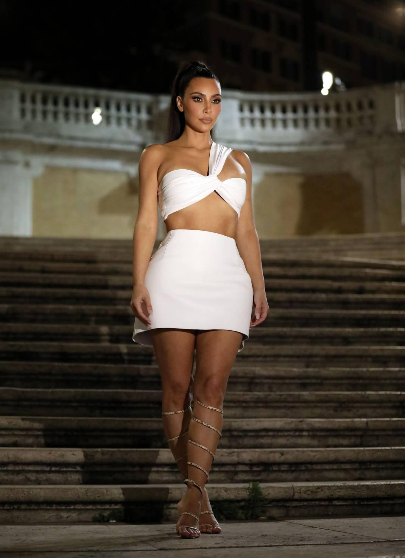 Kim Kardashian rocking a white figure hugging flattering a line skirt