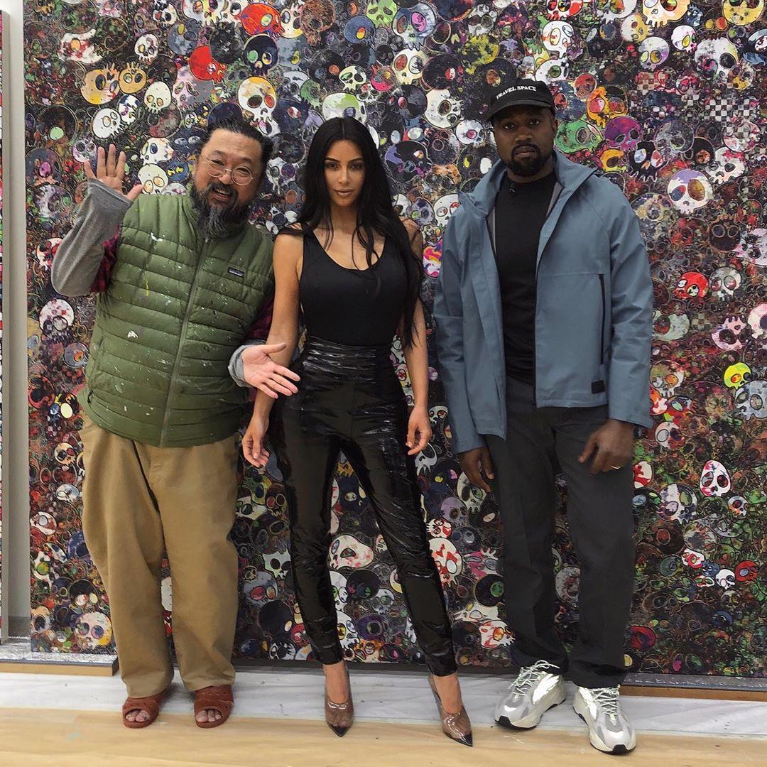 Kim Kardashian rocking see-through black pumps with high heel