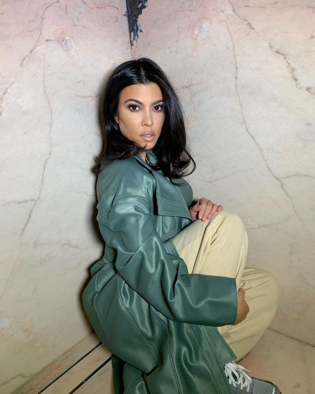Kourtney Kardashian rocking Baggy cream cotton Pangaia sweatpants with a cotton fabric