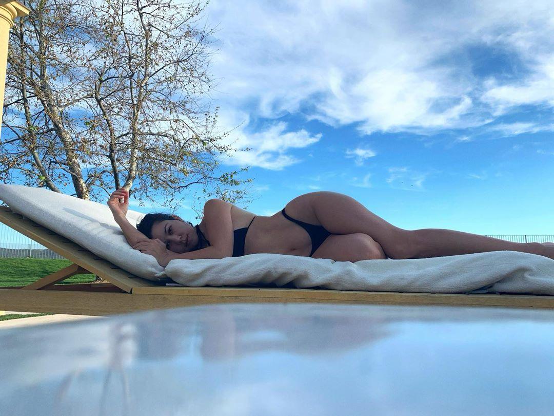 Kourtney Kardashian wearing Black bikini bottom