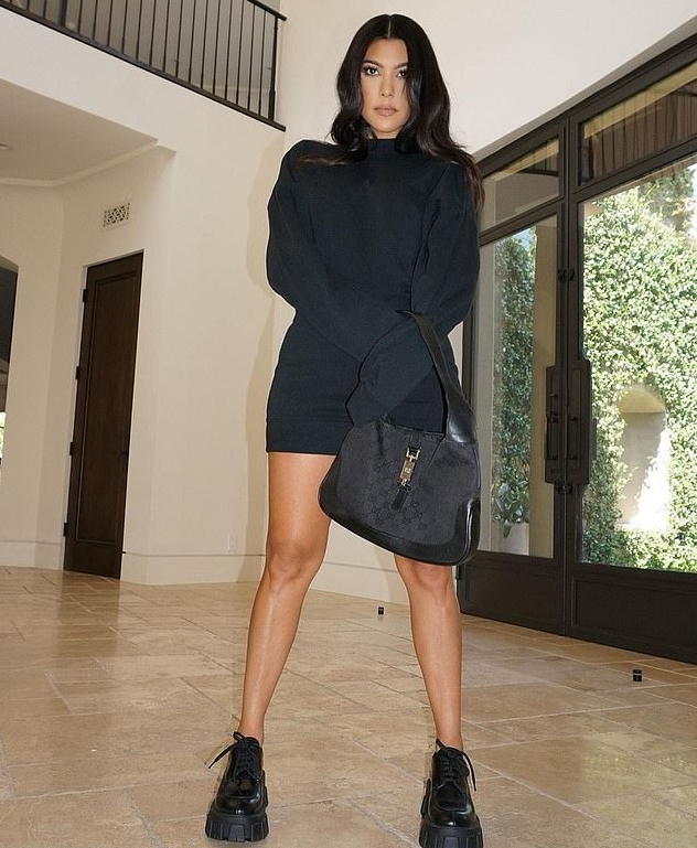 Kourtney Kardashian donning black leather lace-up boots with chunky sole