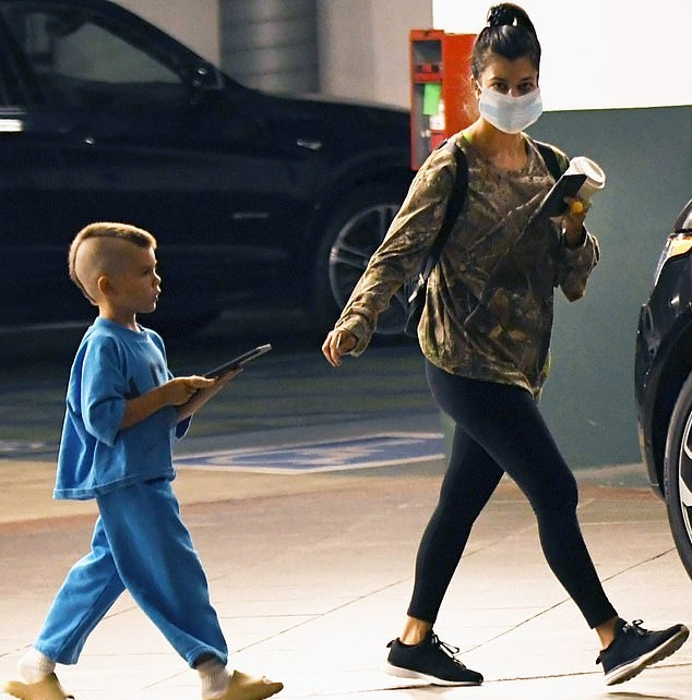 Kourtney Kardashian donning black mesh lace-up sneakers
