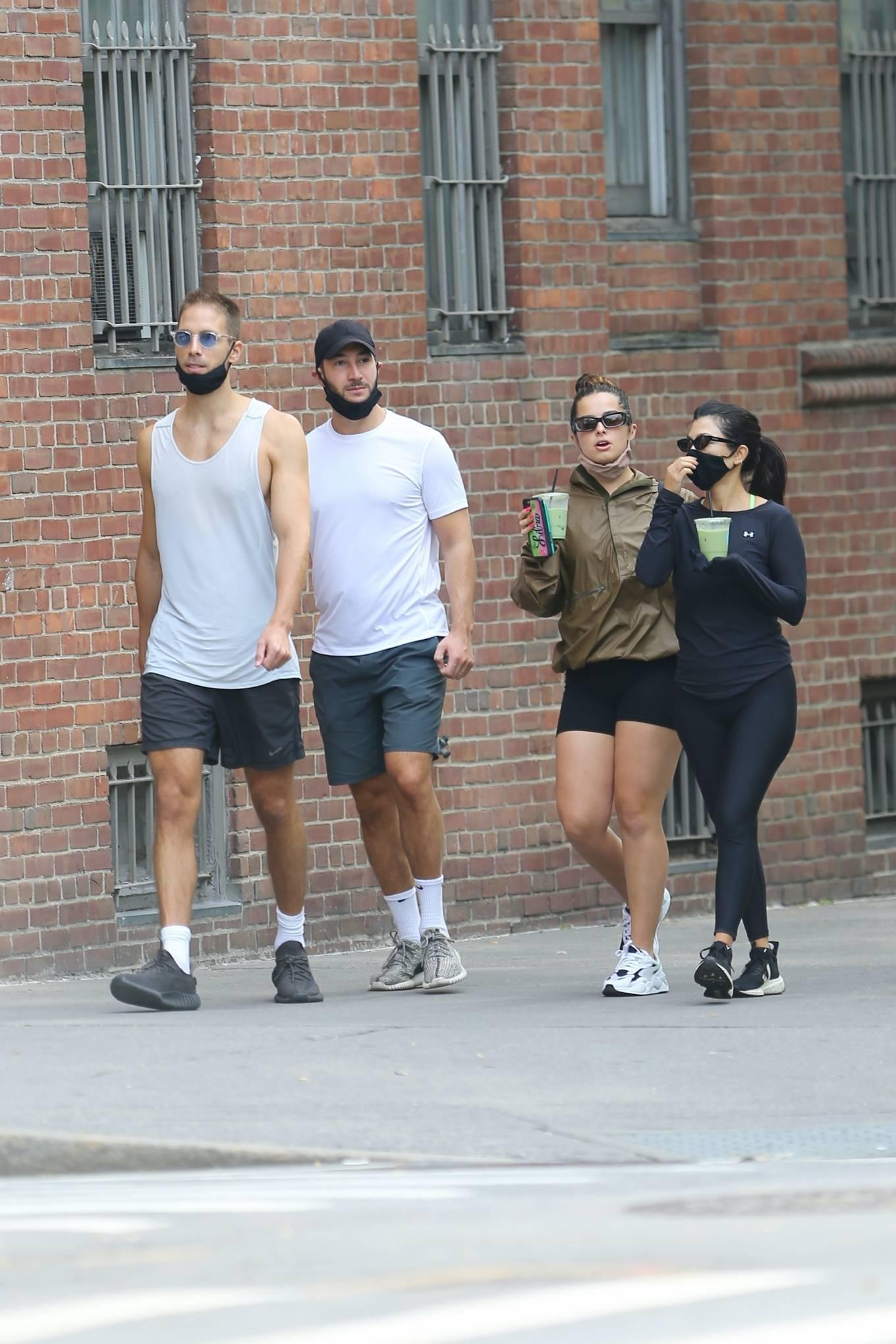 Kourtney Kardashian donning black mesh lace-up sneakers