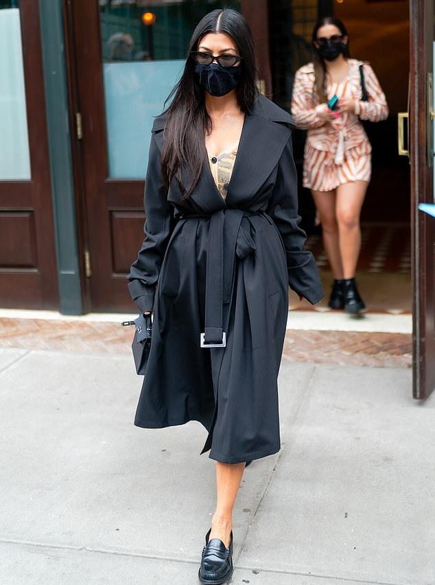 Kourtney Kardashian rocking narrow black leather loafers with square heel