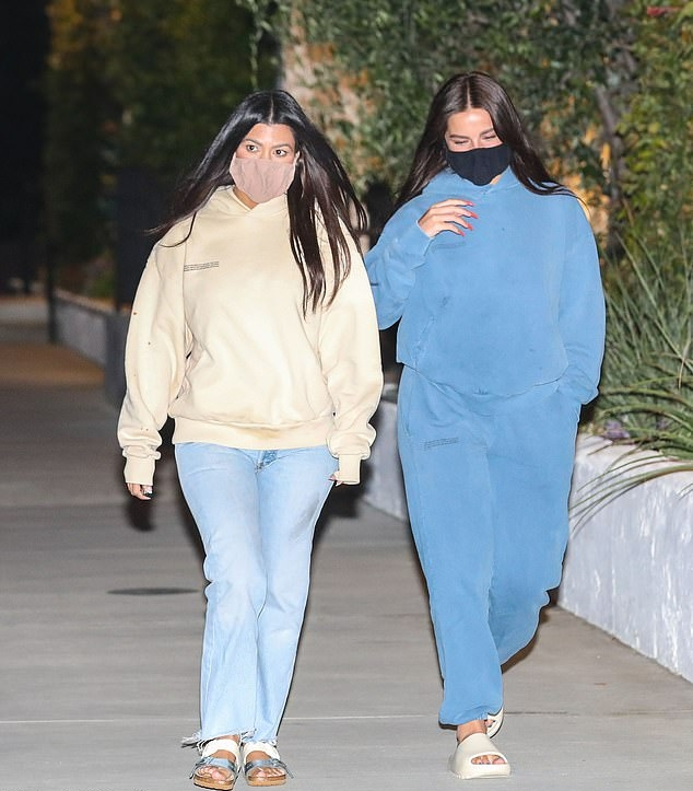 Kourtney Kardashian, oversized, Pangaia  sweatshirt, cream  sweatshirt, light blue jeans, silver Rick Owens flats, casual, hip length, extra long sleeves, crew neck, ribbed trim hem