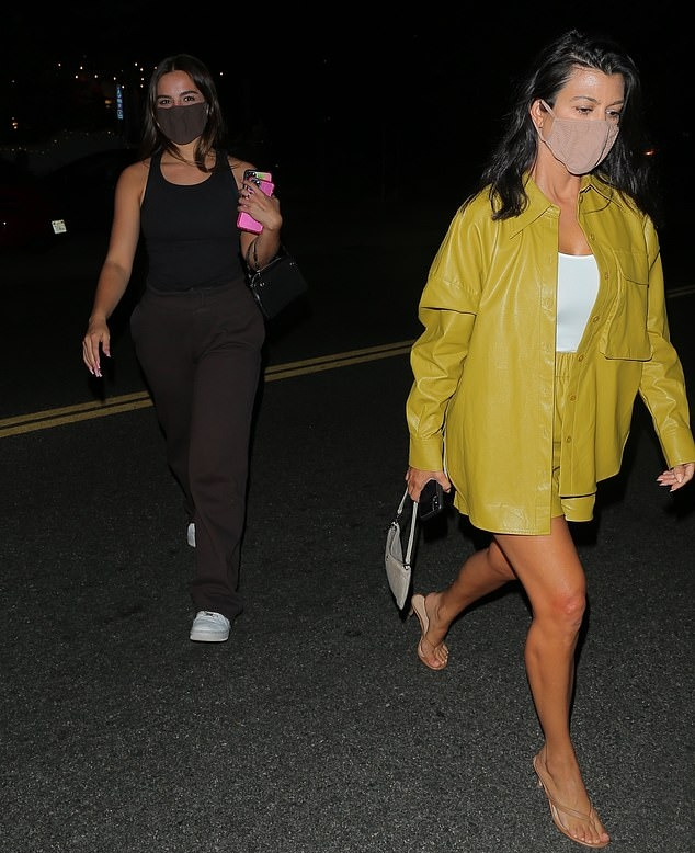 Kourtney Kardashian wearing transparent brown v-strap sandals with pointy heel and strappy