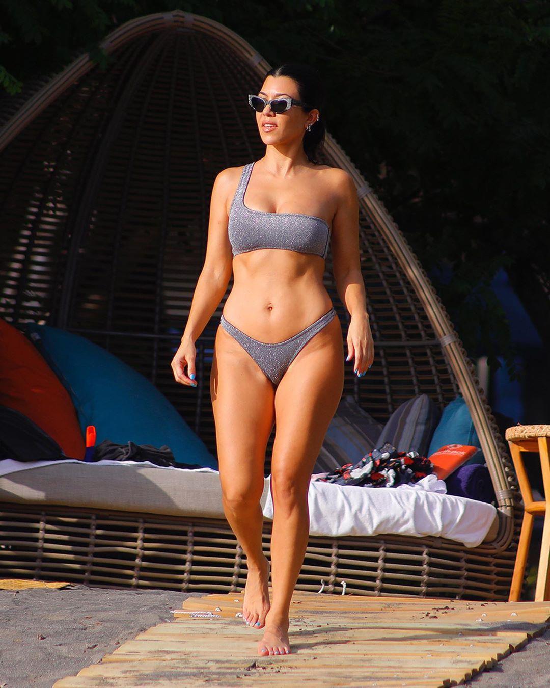 Kourtney Kardashian wearing Glittery grey bikini bottom
