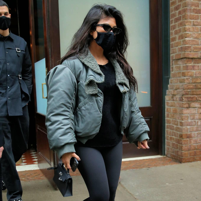Kourtney Kardashian rocking shiny black skinny leggings